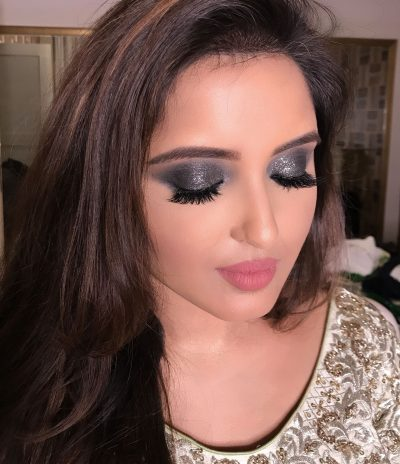 Dubai Bridal Makeup. Bride with closed eyes wearing eye shadow and lipstick