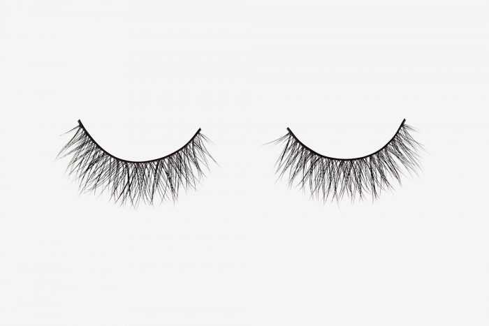 Ella Mink Lashes, two false eyelashes side by side on grey background