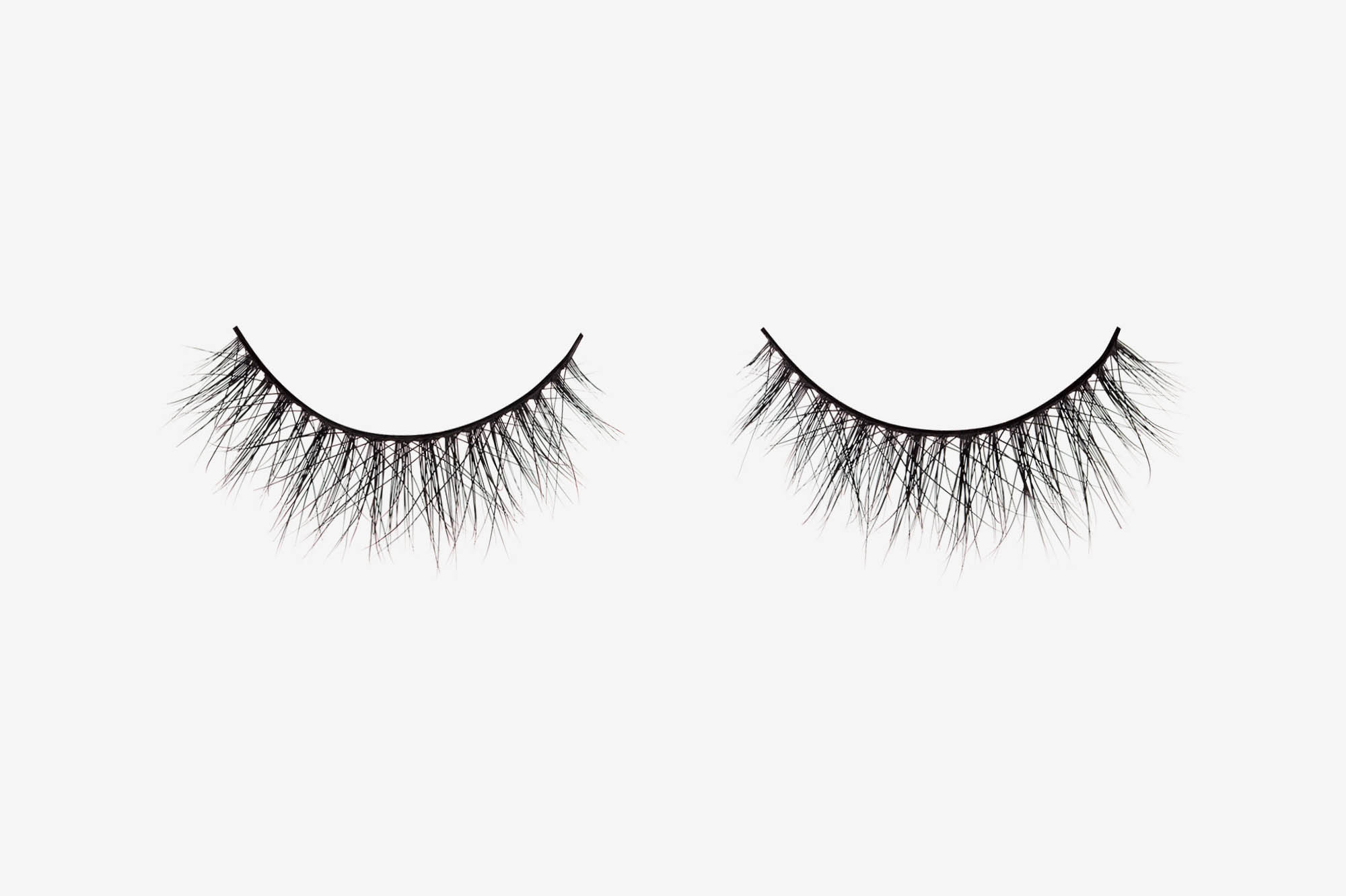 Amelia Mink Lashes, two false eyelashes side by side on grey background