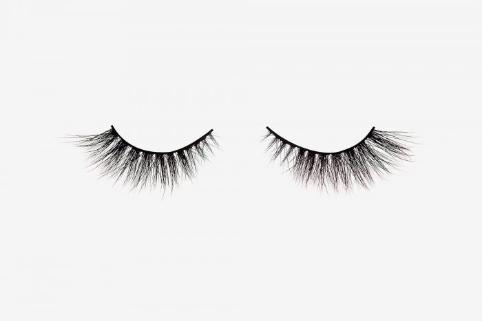 Anya Mink Lashes, two false eyelashes side by side on grey background