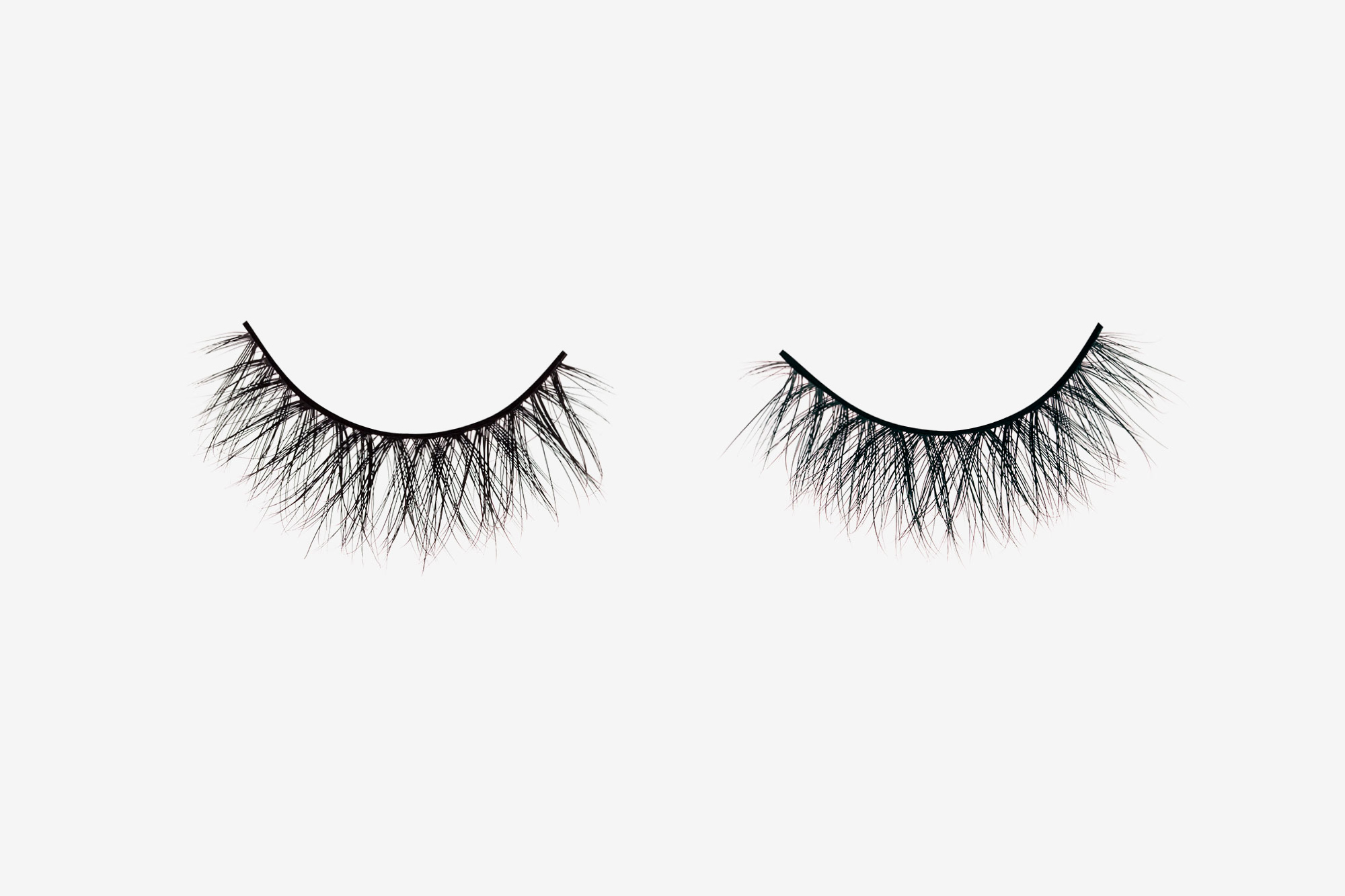 Eva Mink Lashes, two false eyelashes side by side on grey background