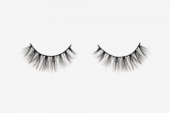 Nina Mink Lashes, two false eyelashes side by side on grey background