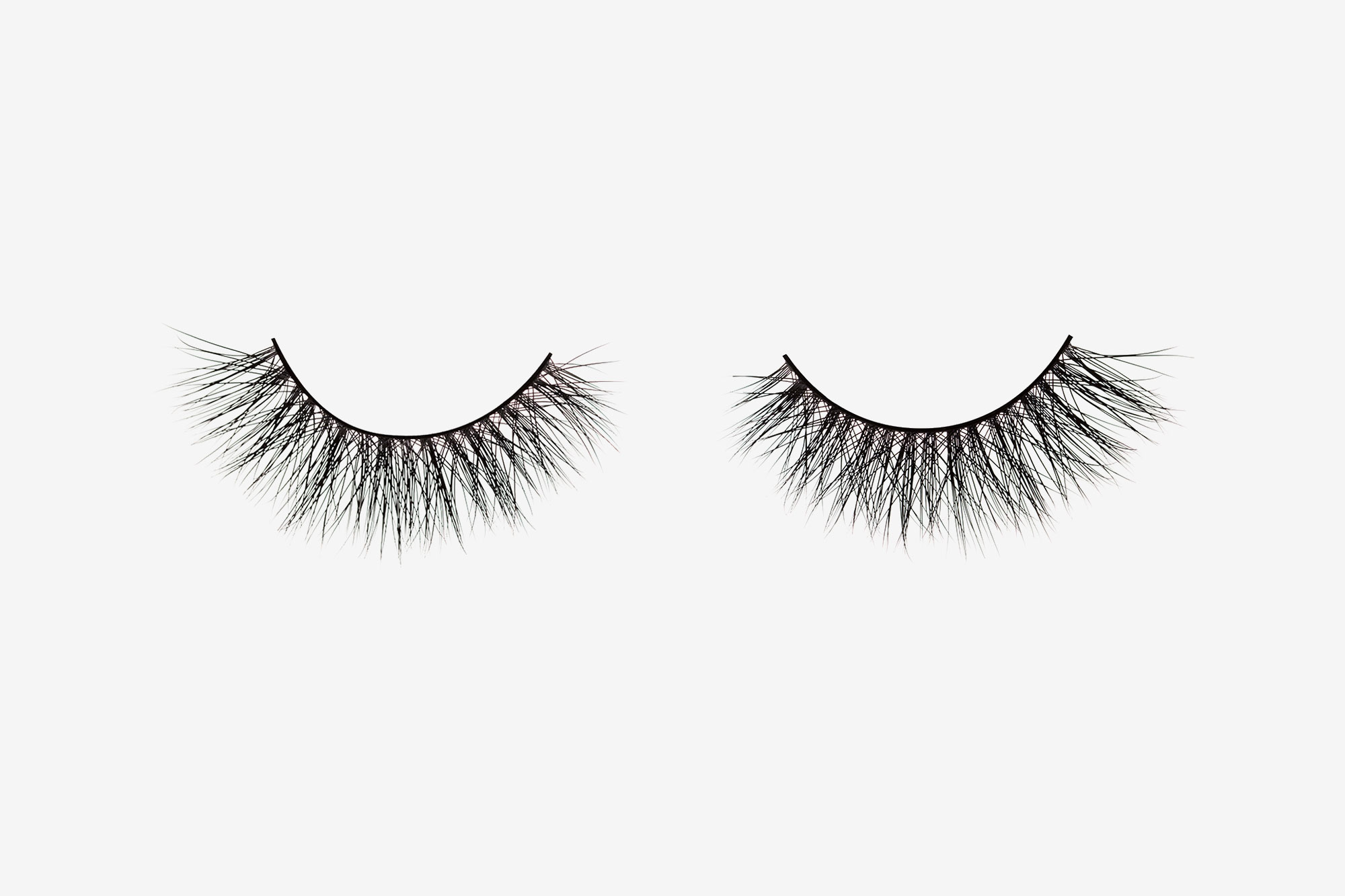 Olivia Mink Lashes, two false eyelashes side by side on grey background