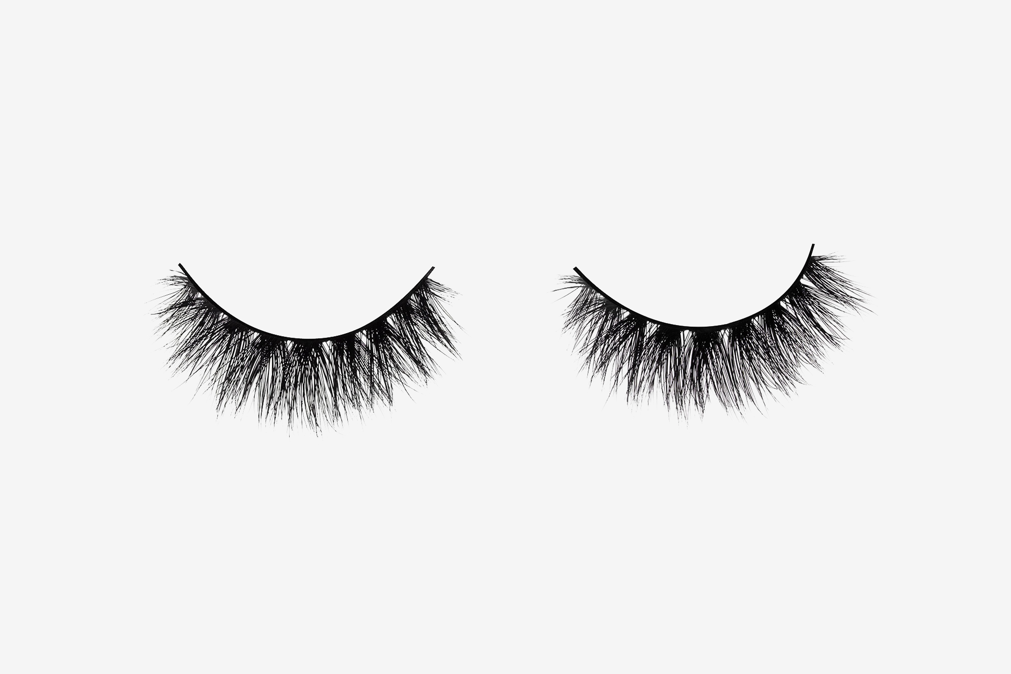 Savanna Mink Lashes, two false eyelashes side by side on grey background