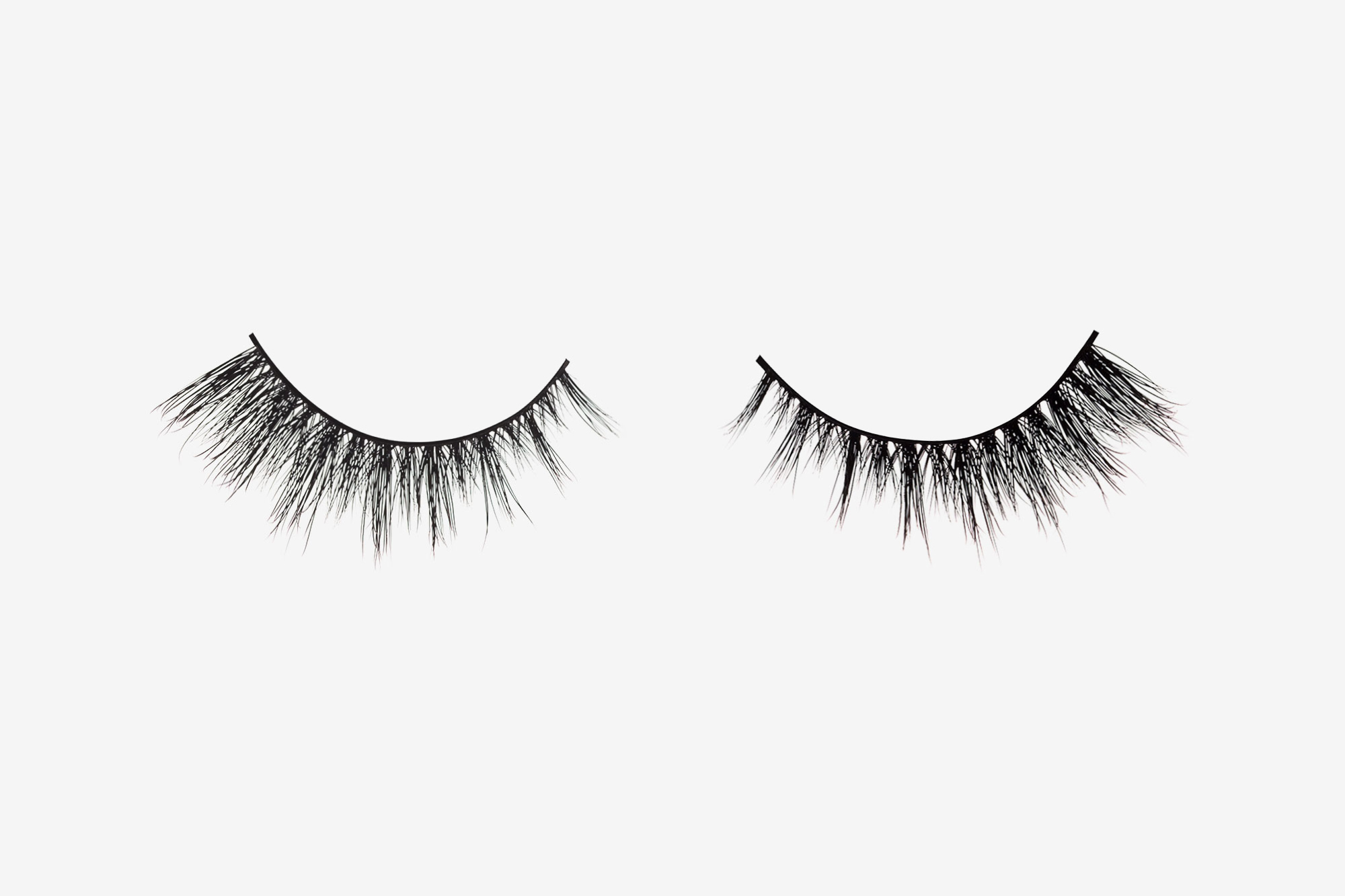 Sienna Mink Lashes, two false eyelashes side by side on grey background