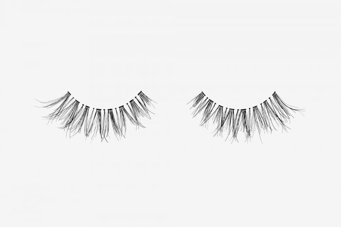 Carey False Eyelashes, pair of false eyelashes side by side on grey background