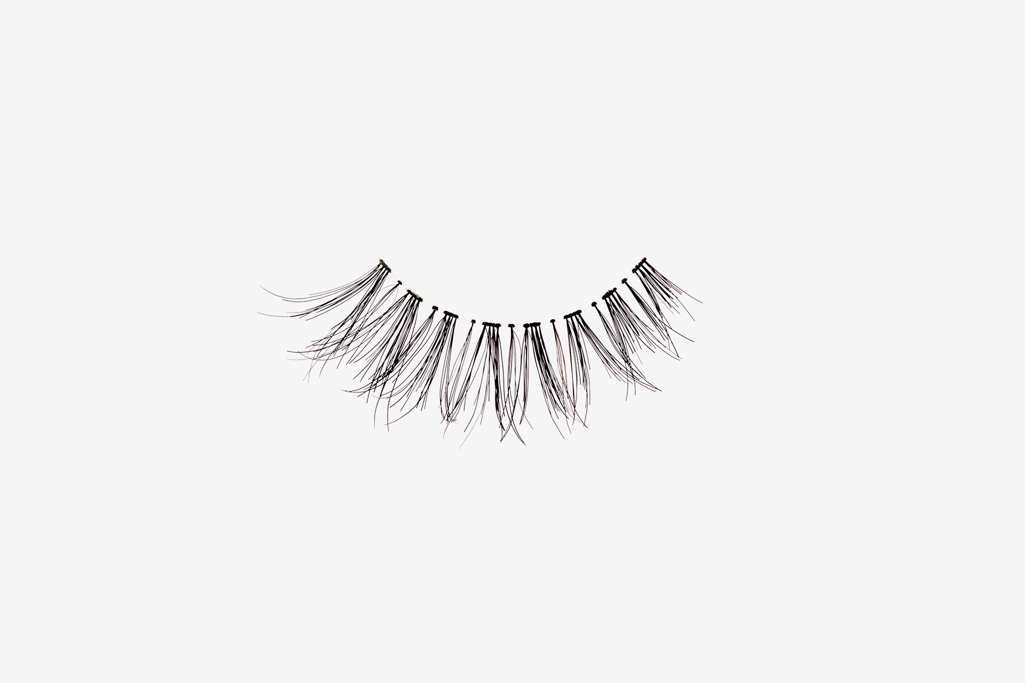 Carey False Eyelashes, single false lash on grey background