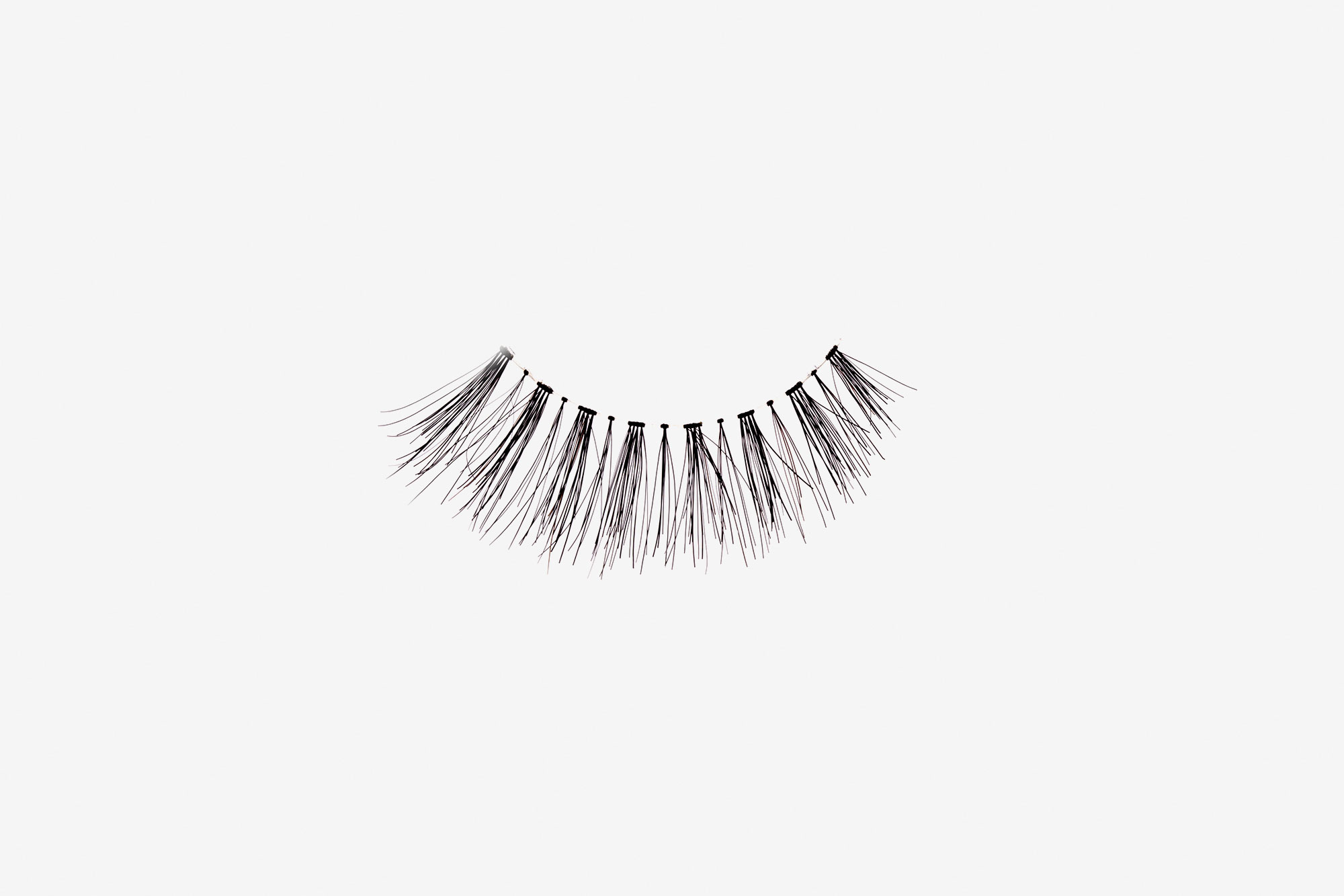 Daisy False Eyelashes, single false lash on grey background