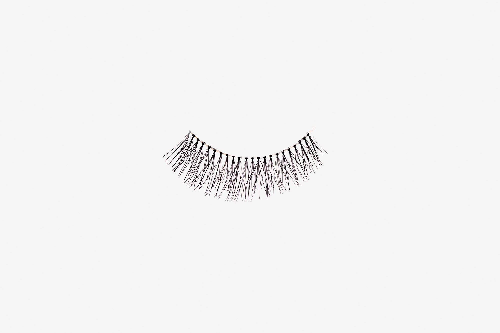Emily False Eyelashes, single false lash on grey background