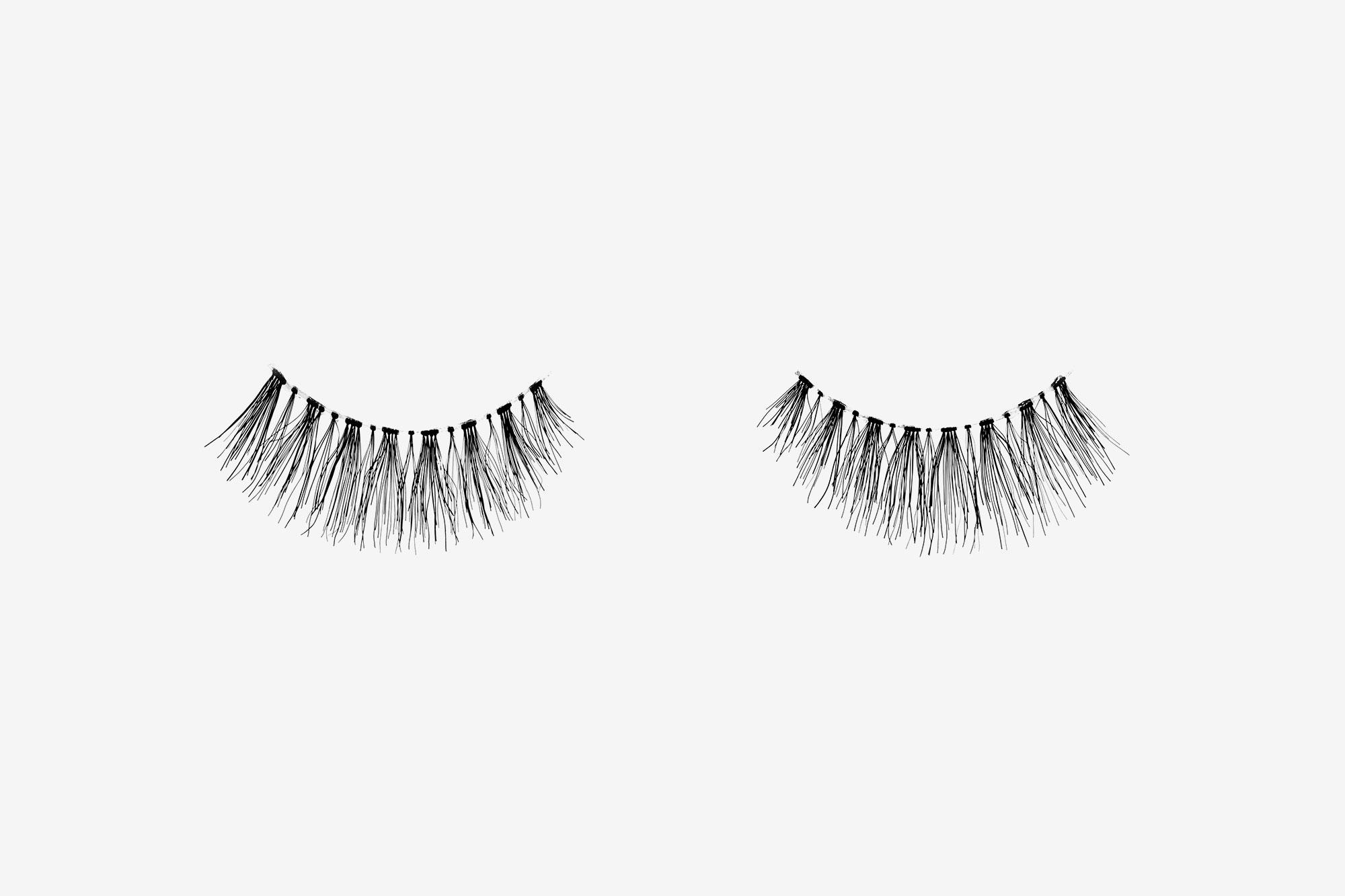 Kourtney False Eyelashes, pair of false eyelashes side by side on grey background
