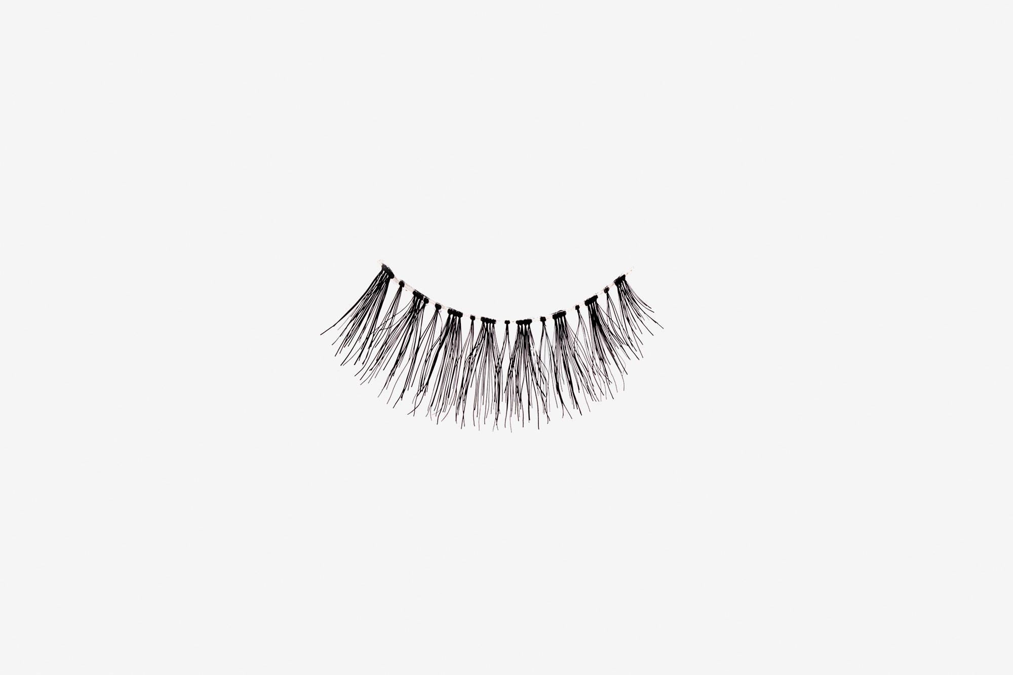 Kourtney False Eyelashes, single false lash on grey background