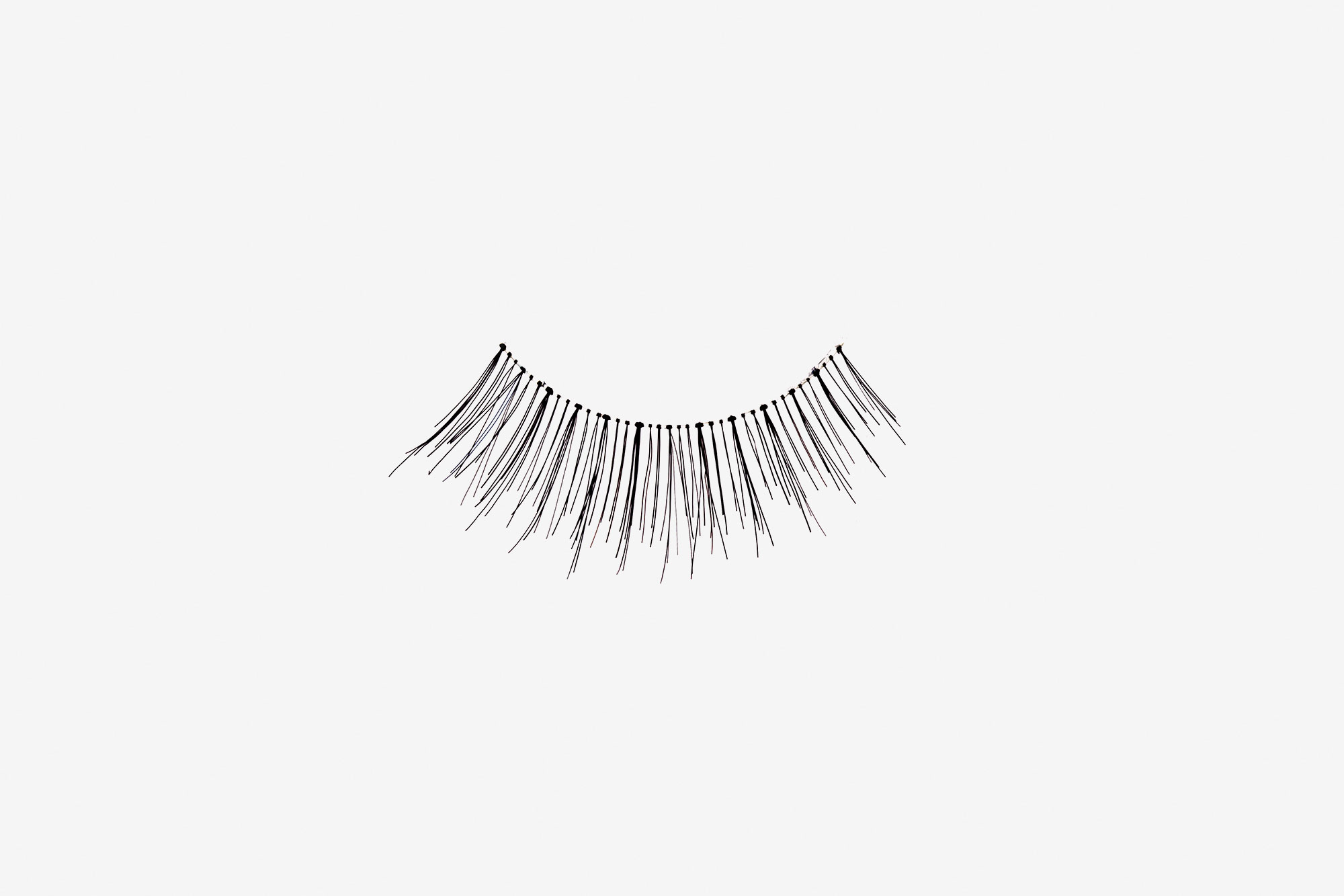 Lilly False Eyelashes, single false lash on grey background